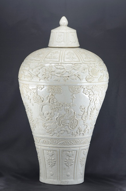 A rare carved qingbai vase, Meiping